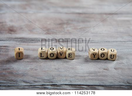 I love you lettering on small cubes. Rustic wooden floor