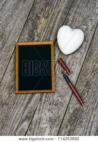 White Heart, Blackboard And Pen