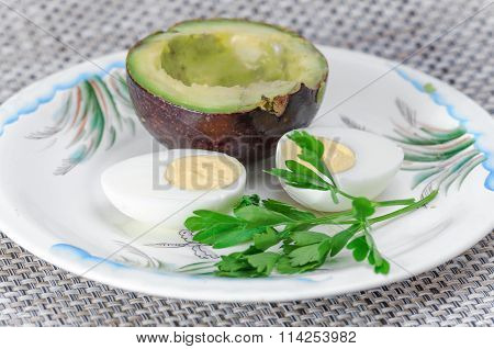 The Half Of The Fruit Avocado, And Boiled Egg