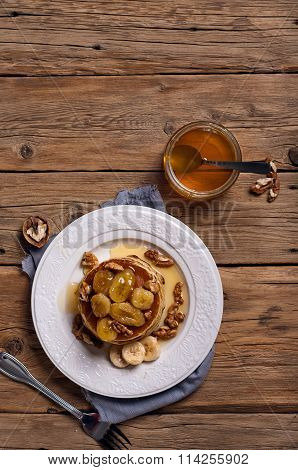 Golden Pancake With Caramelized Bananas, Honey And Nuts