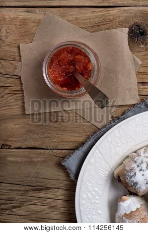 Jar Of Tasty Apricot Jam With Croissants