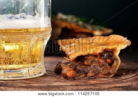 Piece Of Australian Meat Pie With A Glass Light Beer