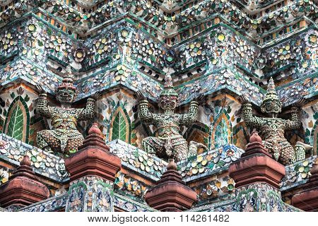 Demon Guardian Statues Decorating The Buddhist Temple Wat Arun In Bangkok, Thailand