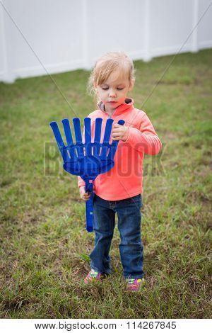 Toddler With Toy Rake