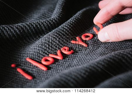 Man wrote a confession of love in red letters