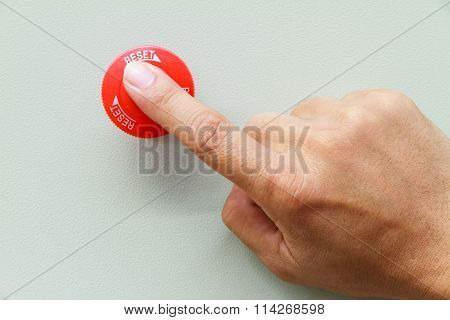 Finger Touch On Red Emergency Stop Switch And Reset