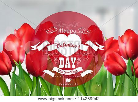Valentine red tulip background with a close up view with a red round label decorated