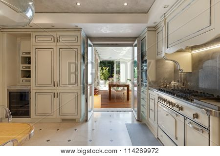 Architecture; domestic kitchen in classic style, veranda view