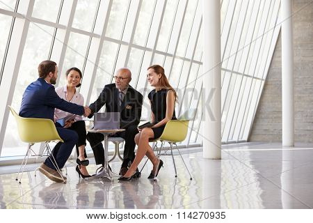 Group Business Meeting In Reception Of Modern Office