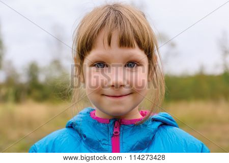 Portrait of a beautiful young girl on the nature