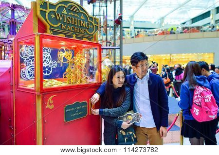 HONG KONG - DECEMBER 25, 2015: people in the Landmark shopping mall. The Landmark, also known as