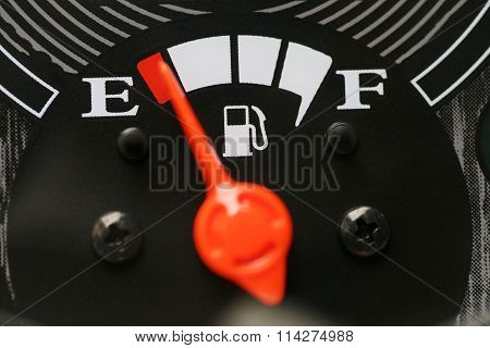 Fuel Gauge With Warning Indicating Low Fuel Tank.