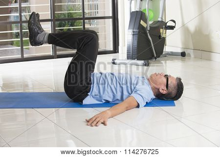 Asian Senior Male Streching At The Gym