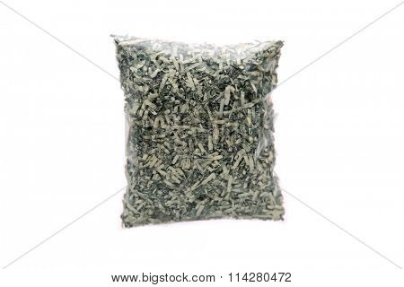 US currency in shreds. In a plastic bag. Isolated on white with room for your text.