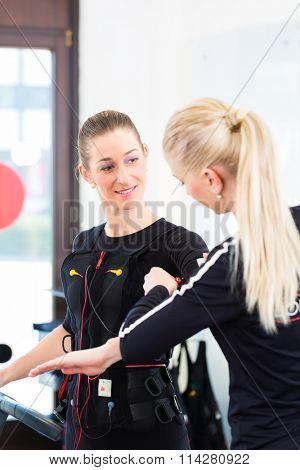 Female coach dress woman in ems electro muscular stimulation costume