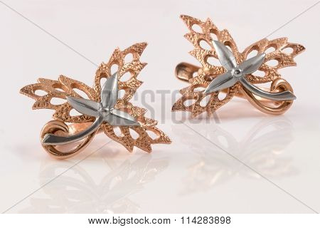 Gold Earrings In The Form Of Maple Leaves Embellished With Platinum On White