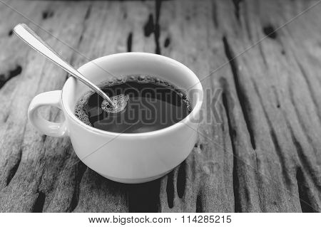 Hot Coffee On Old Wooden Background And Free Form Copy Space. Black And White Picture Style.