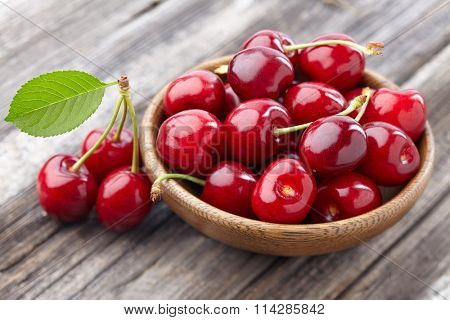 Cherry on a wooden background