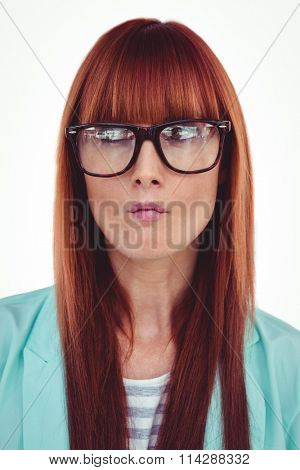 Portrait of a perplexed hipster woman against white background