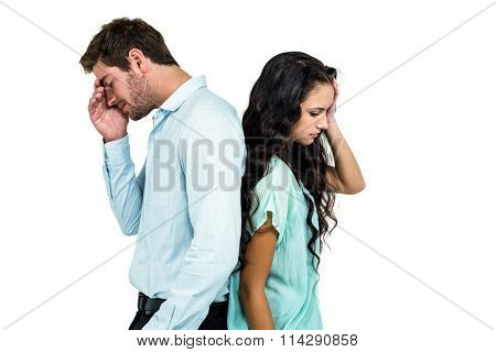 Couple standing back to back not talking after argument on white screen