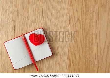 Soft Red Heart On Wood Table