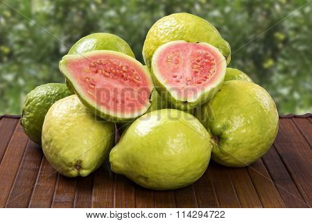 Some Brazilian Guavas Over A Striped Surface.