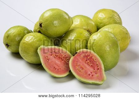 Some Brazilian Guavas Over A White Background.