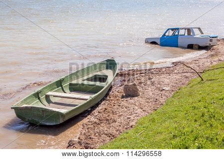 car and boat in the river water