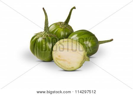 Some Green African Eggplants Over A White Background