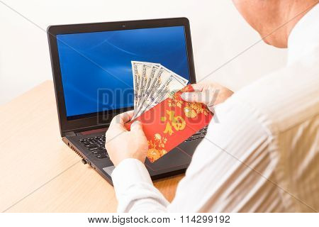 Employee Displaying Red Packet With Good Fortune Character In Office