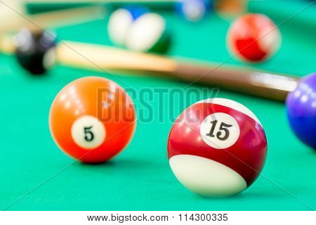 Multicolored Balls On Green Baize Of Billiard