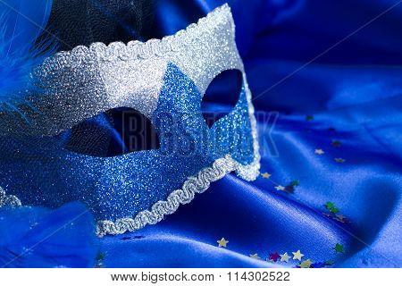 Carnival mask on blue background