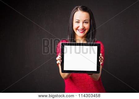 Woman holding tablet with blank screen