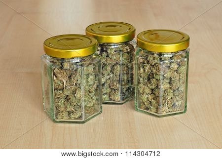 Dry Cannabis Buds In Glass Jars