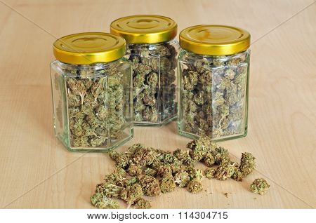 Dry Cannabis Buds Stored In Glass Jars