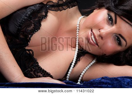 Beautiful Young Woman Lying Dressed In Black Lingerie