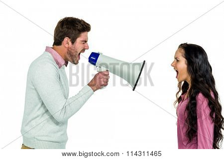 Shouting couple with man holding loudspeaker on white background