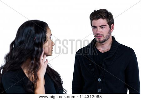 Sad couple looking at each other on white background