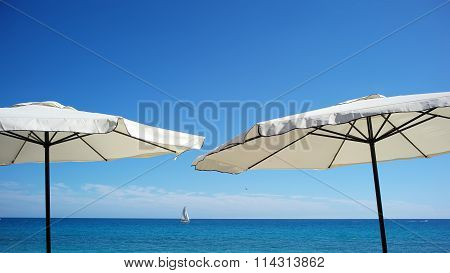 Beach Umbrellas At Seashore