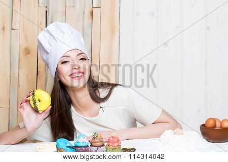 Female Cook With Desserts
