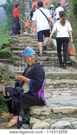 woman is sitting outdoor in Sa Pa, Vietnam