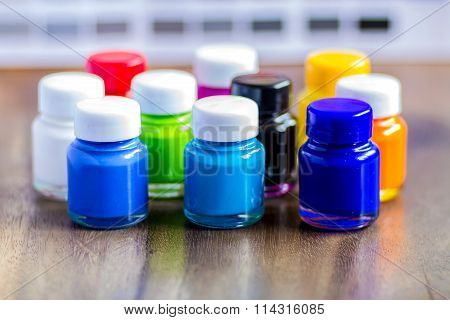 Bottles Color On Wood With Background Color Chart