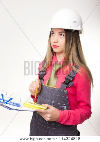beautiful woman civil engineer holding blueprints. young female architect