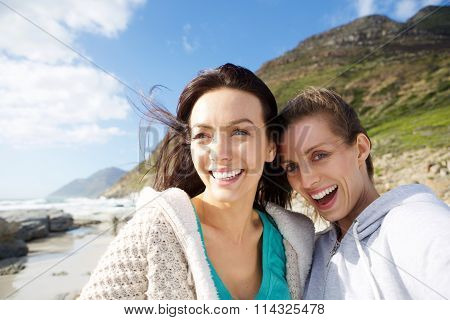 Two Smiling Women Friends Taking Selfie