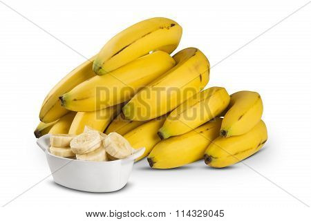 A Banch Of Bananas And A Sliced Banana.