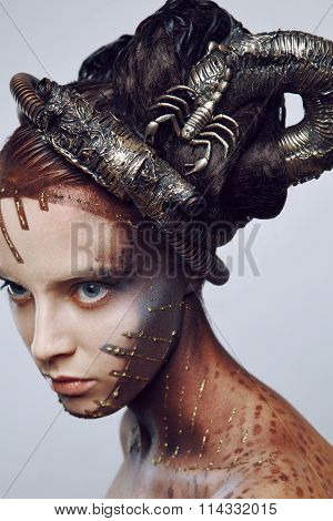 Portrait of beautiful woman & scorpion