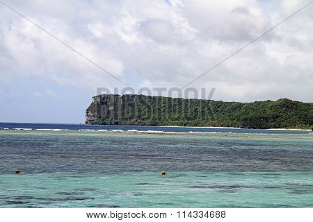 Two lovers point from Tumon beach in Guam Micronesia