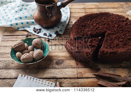 Chocolate cake, coffee and cinnamon sticks