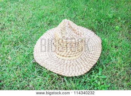 Beautiful Straw Hat In The Green Grass