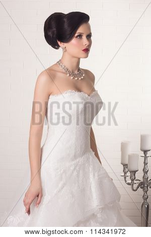 Young gorgeous bride. Beautiful and fashion bride in luxury interior. Beautiful and fashion bride wi